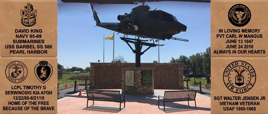 memorial walkway with an honorable memorial and air force helicopter above